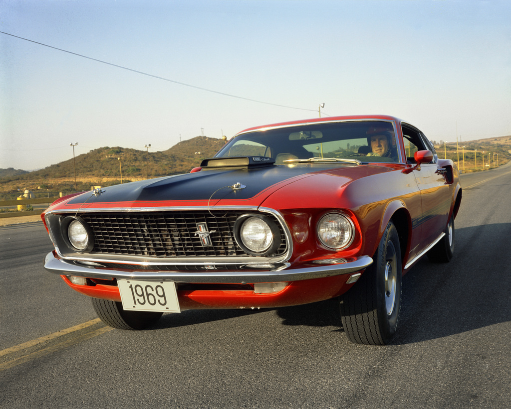"""1969: A """"steed for every need"""" philosophy yields 11 different powertrain combinations. New models added to the lineup include the 290-horsepower Boss 302, the 375-horsepower Boss 429, plus the Mustang Mach 1 and the Grande luxury model"""