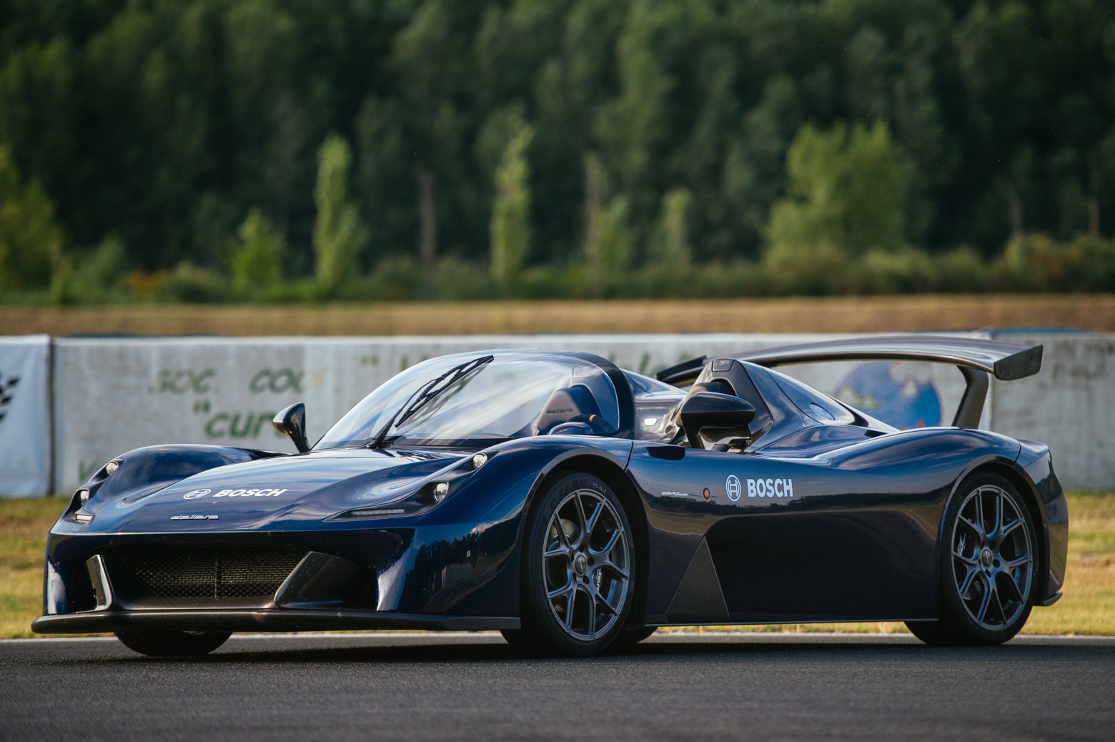 Blue Dallara Stradale with optional wing and Bosch livery.