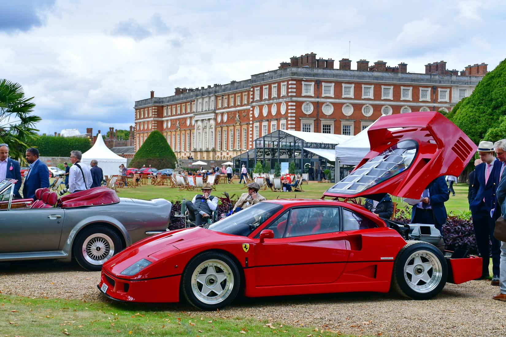 A red Ferrari F40 with open bonnet on display during the Concours of Elegance with Hampton Court Palace in the background