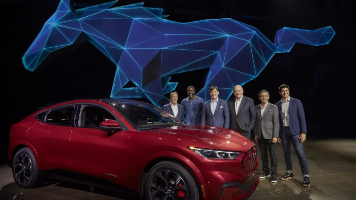 From left, Ford Motor Company Executive Chairman Bill Ford, actor Idris Elba, Ford President of New Businesses, Technology and Strategy Jim Farley, Ford Motor Co. President and CEO Jim Hackett, Ford Chief Product Development Officer Hau-Thai Tang and Ford Enterprise Product Line Director for Global Electrification Ted Cannis at the reveal of the all-electric Ford Mustang Mach-E SUV at Jet Center Los Angeles in Hawthorne, California on Sunday, Nov. 17, 2019.