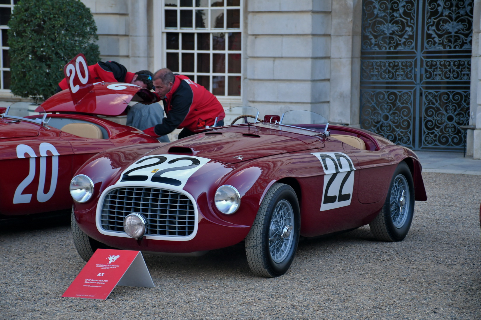 Red Ferrari 166MM from 1949 chassis number 0008 with the racing number 22 on the sides