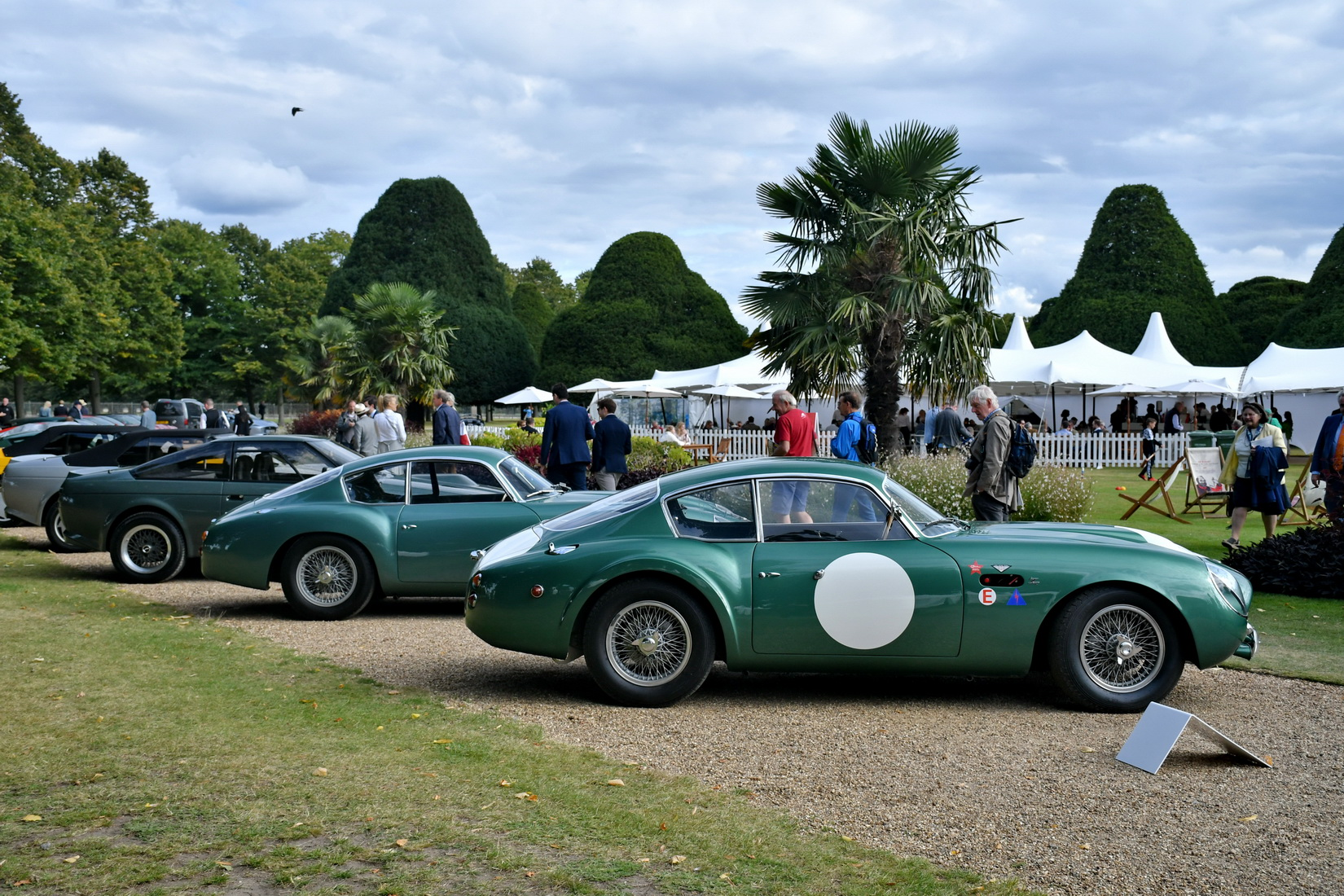 Two green Aston Martin DB4 GT Zagato from 1961 standing side by side