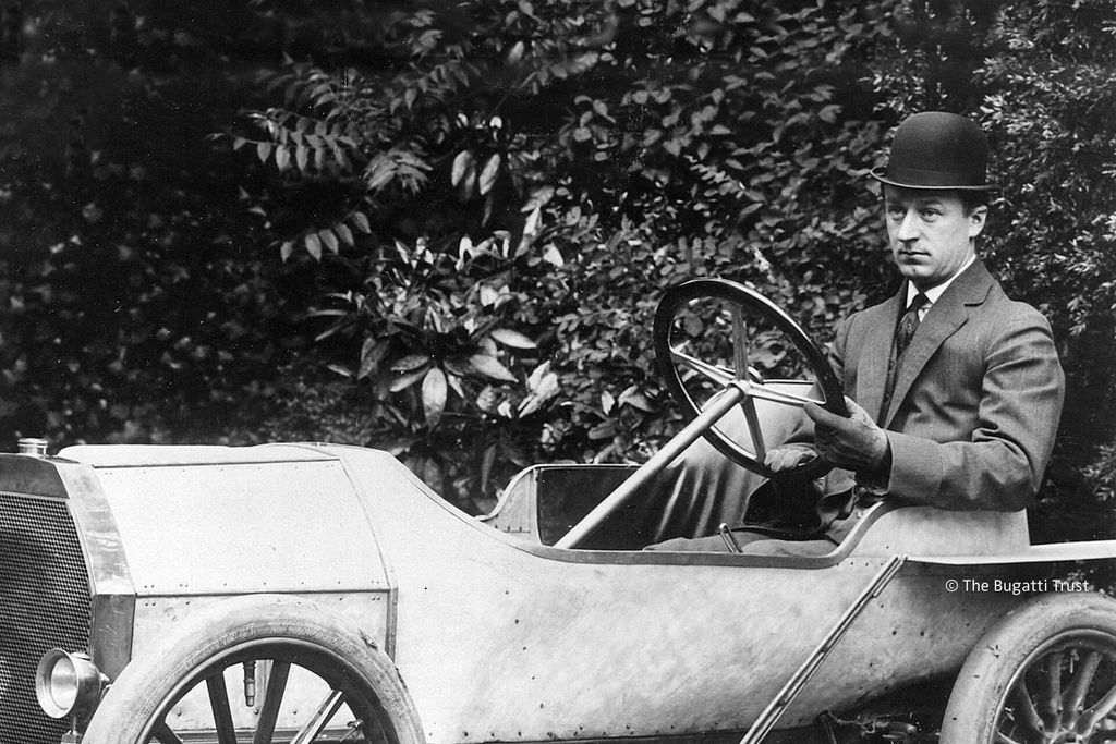 Ettore Bugatti and his Bugatti Type 10 Automobile.