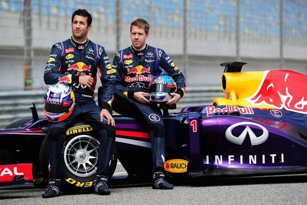 Vettel and Ricciardo with the RB10 Formula 1 car