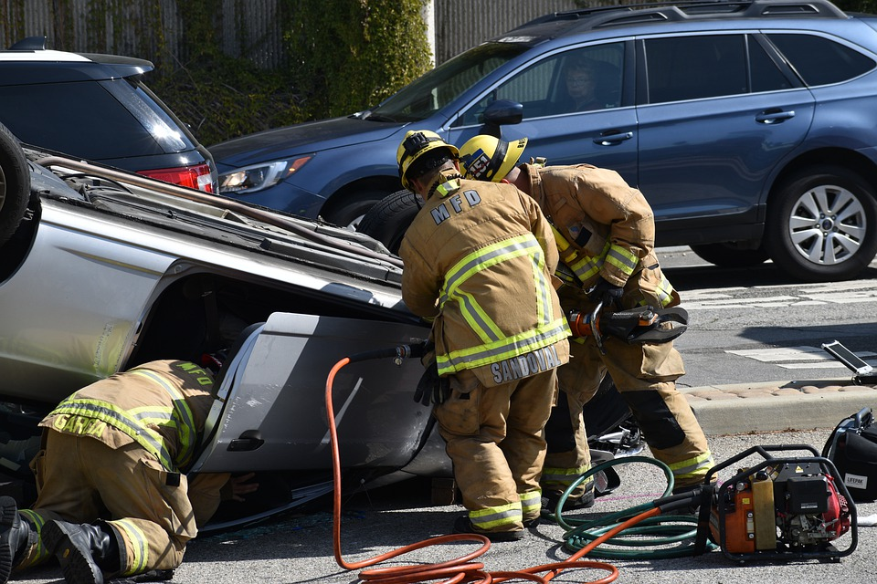 Firemen rescuing someone from accident wreck