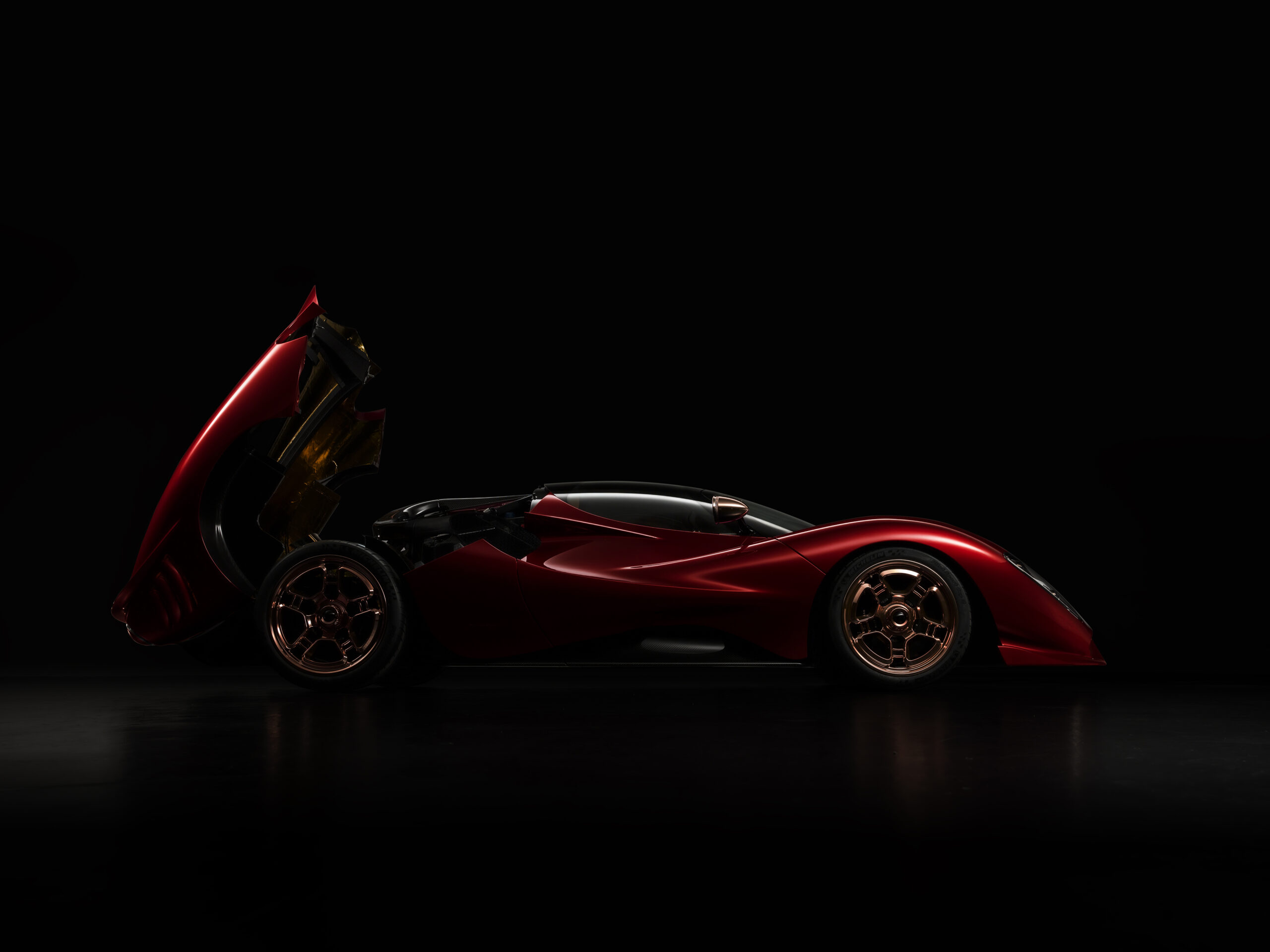 Side view of the P72 hypercar with engine door open