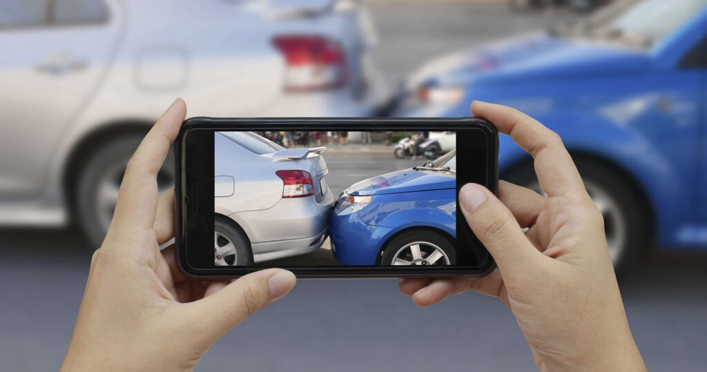 Taking photos of car crash damage for insurance with a smartphone