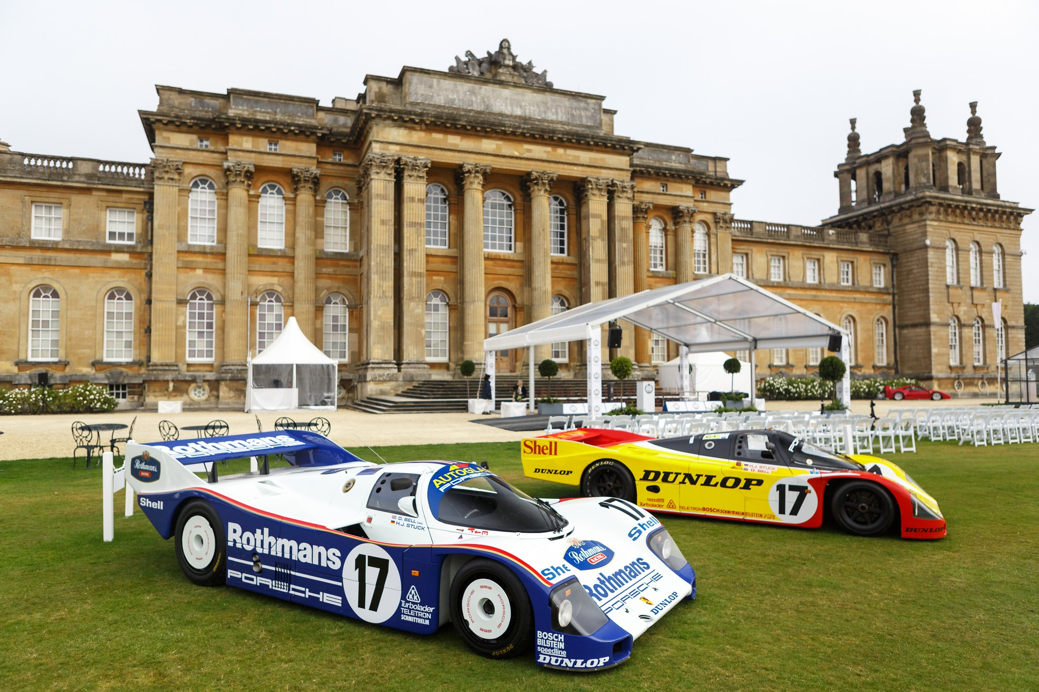 Historic Porsche Endurance Racers stand in front of Blenheim Palace